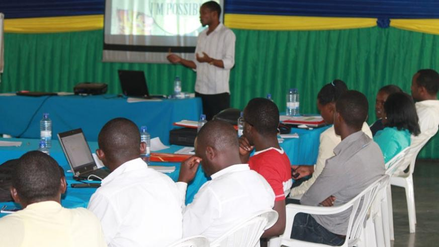An instructor takes the librarians through a panel discussion. (Moses Opobo)