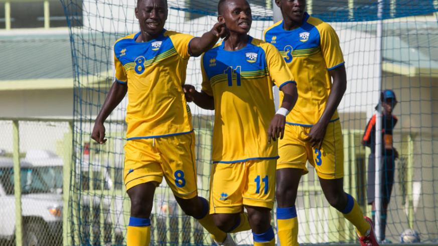 Blaise Itangishaka (L) celebrates with teammates after giving Rwanda the lead against Uganda yesterday at Kigali Regional Stadium. (Timothy Kisambira)