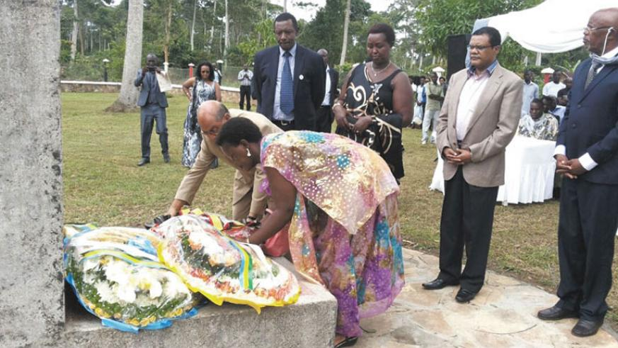 Ugandan philanthropist Muhmood Thobani lays a wreath on one of the mass graves at Ggolo, Mpigi district last year. Looking on behind on the left is Rwanda's High Commissioner to Ug....