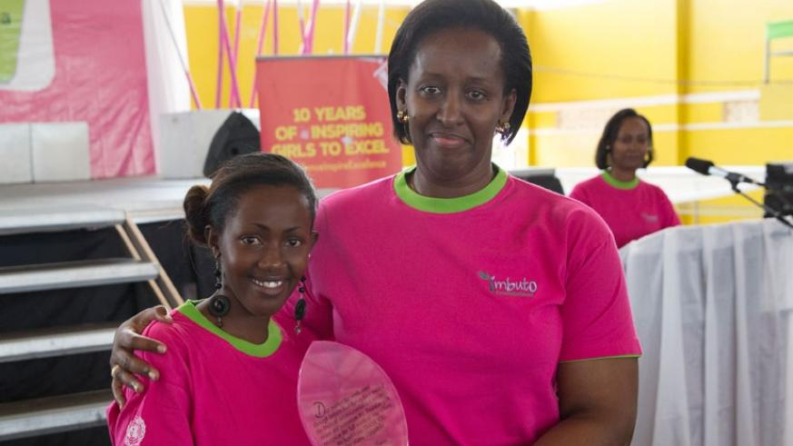First Lady Jeannette Kagame poses with a Best Performing Girl on the 10th anniversary of the Campaign held in Kigali on 5 July 2015. 36 Best Performing Girls (BPGs) will today be r....