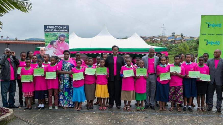First Lady Jeannette Kagame and guests pose with the best performing girls. (Courtesy)