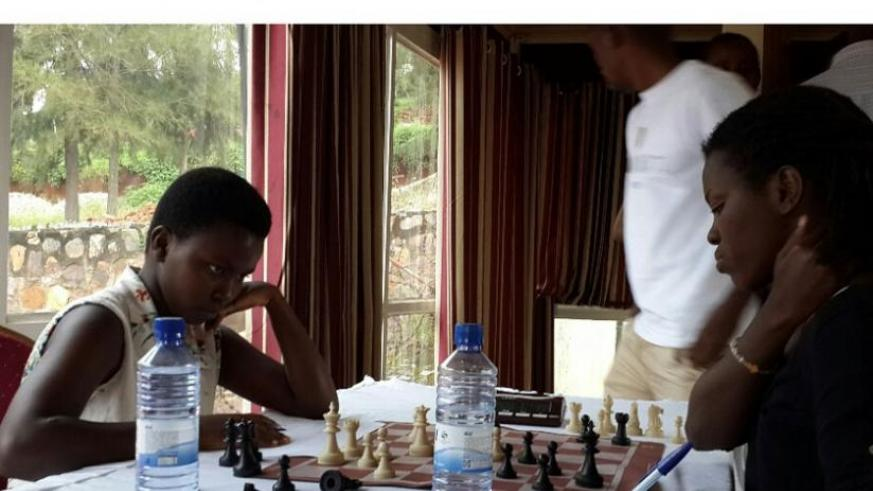 Joselyne Uwase (L), 13, surprised everyone, including herself when she tricked and overpowered an unsuspecting female national chess champion, Marie Faustine Shimwa. (James Karuhanga)