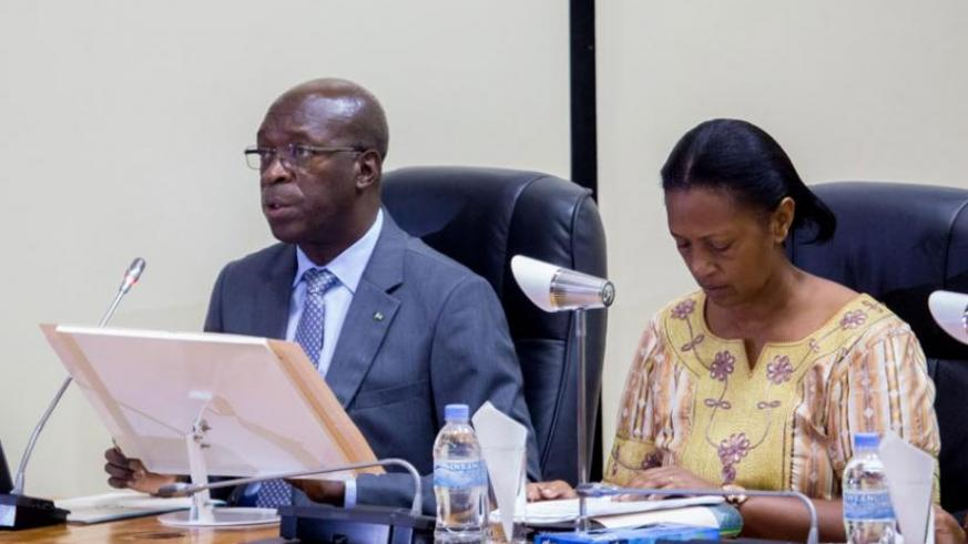 Prime Minister Anastase Murekezi addresses Parliament yesterday about plans to phase out the commercialisation of second-hand clothes and footwear. Right is Senate vice-president J....