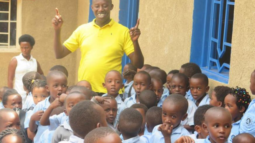 Albert Musabyimana plays with the kids. (Lydia Atieno)