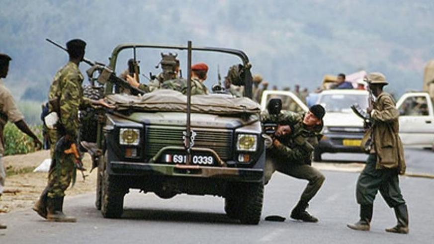 French soldiers hand over an unwilling Genocide victim to militiamen at a road block during the 1994 Genocide against the Tutsi. (File)