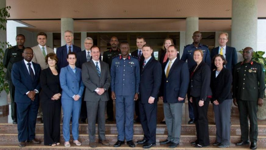 Brig Gen Karamba (5th L) in a group photo with the visiting delegation from the US National Defence College. (Timothy Kisambira)