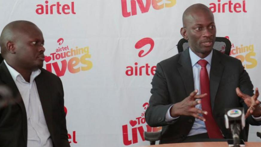 """Adjei (right) explains the nomination process for the """"Airtel Touching Lives Initiative"""" beneficiaries as Brian Kirungi, the Airtel head of legal and regulatory affairs, looks on. ...."""