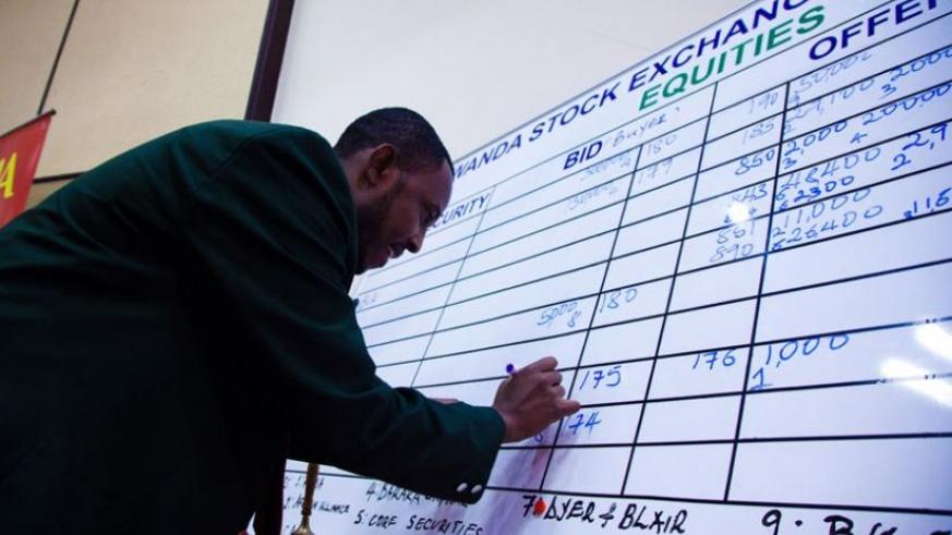An employee of RSE records bids from investors during a trading session. The bond market was active yesterday. (File)