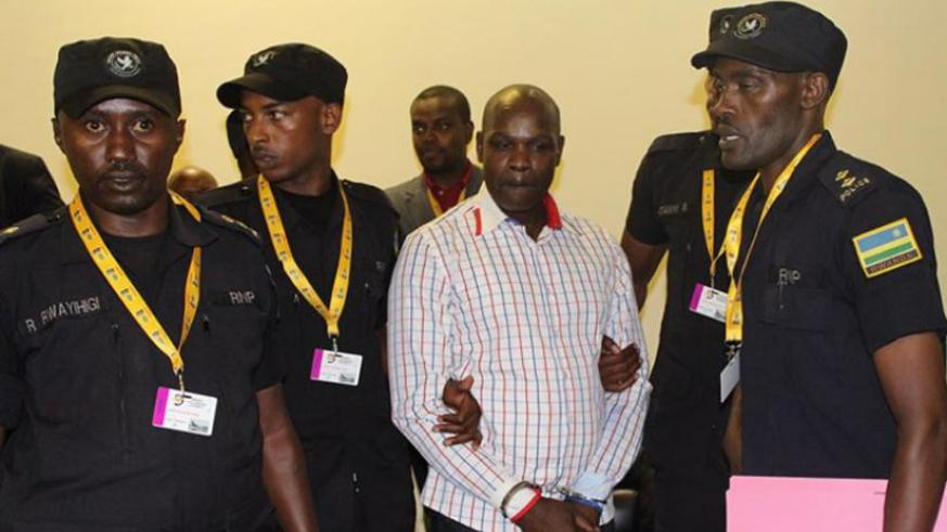 Police officers take Ntaganzwa into custody after he was extradited from DR Congo last month. (File)