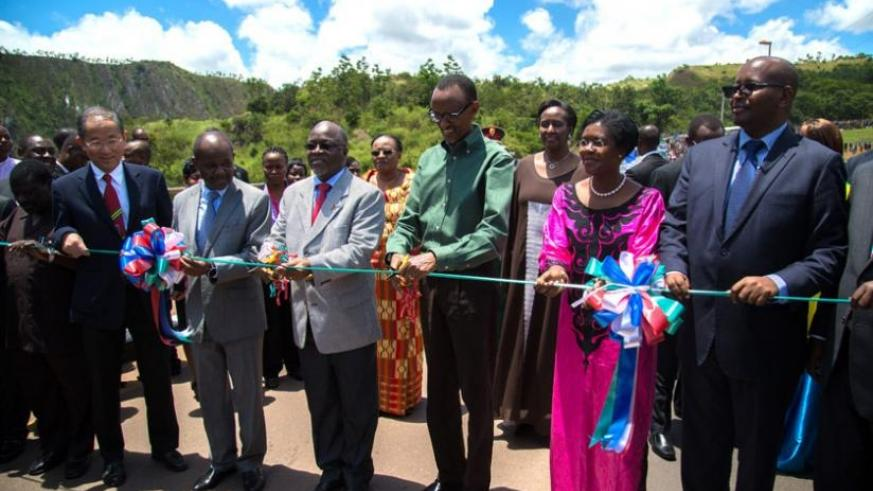 Presidents Paul Kagame and John Pombe Magufuli (3rd left) cut the ribbon to mark the inauguration of the Rusumo one-stop border post yesterday. (Village Urugwiro)