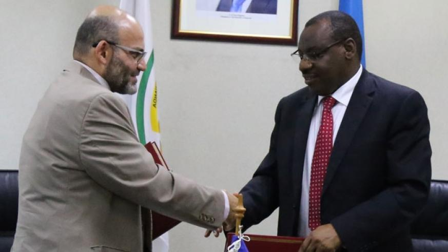WB Rwanda chief Yasser El-Gamal (left) and Gatete exchange documents after signing the funding agreement on Wednesday in Kigali.  (Courtesy)