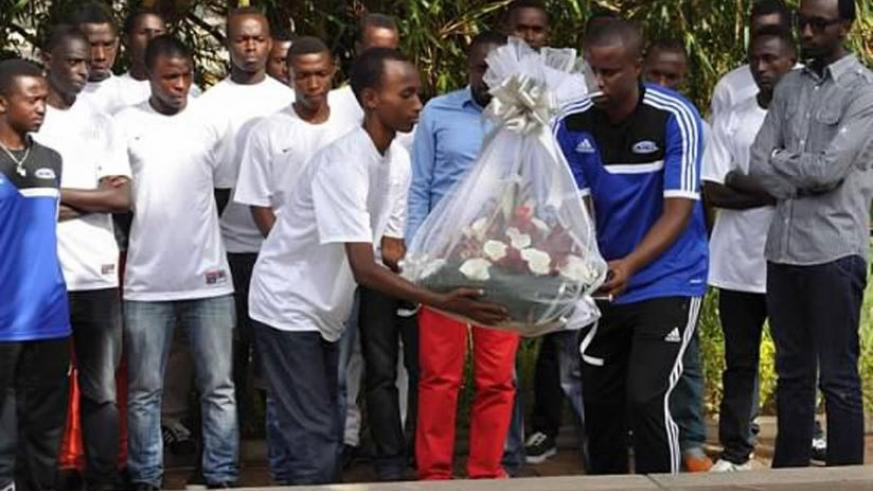 Dream Team FA coaches and players lay a wreath at a mass grave at Kigali Genocide Memorial  Centre last year. (File)