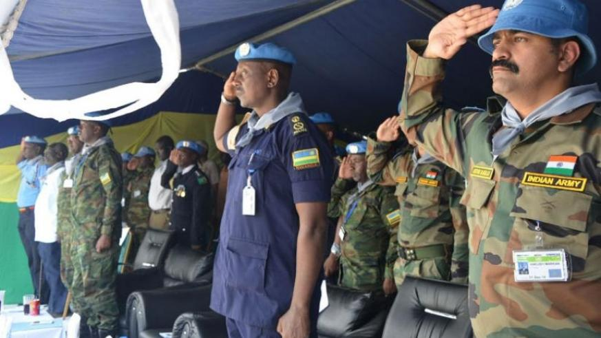 ACP Rogers Rutikanga (C), the commander of Formed Police Unit in UNMISS, South Sudan, with other officers at the Genocide commemoration event in Malakai, South Sudan, yesterday. (Courtesy)