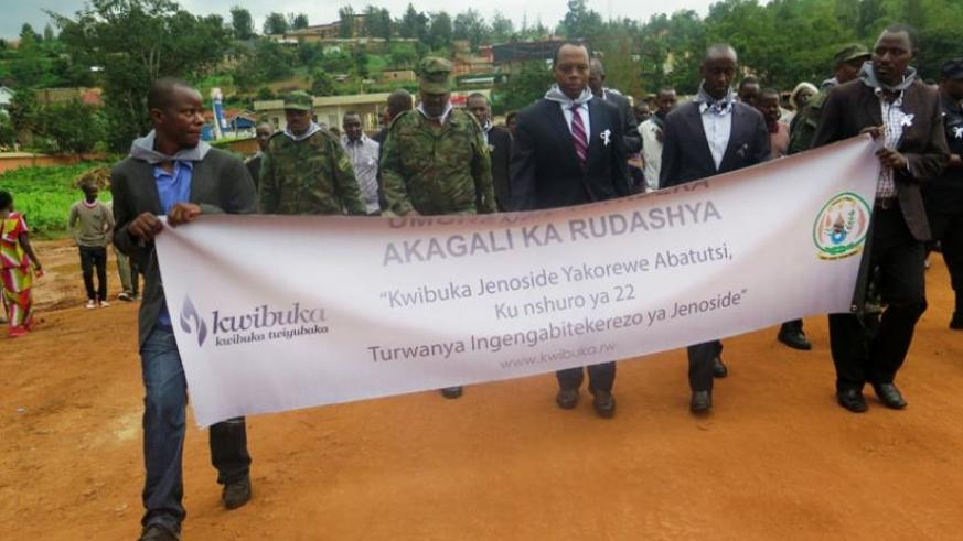 RDB CEO Francis Gatare (3rd L), Gasabo district mayor Stephen Lwamurangwa (2nd R) and other Rwandans during the march to start the Genocide  commemoration activities in Gasabo yest....