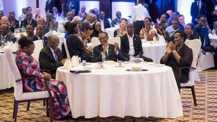 President Paul Kagame and First Lady Jeannette Kagame share a light moment with their Tanzanian counterparts, Dr John Pombe Magufuli and Janeth Magufuli, at the state dinner in Kig....
