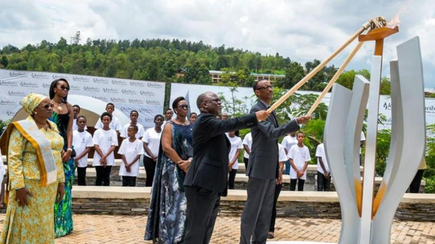 Presidents Kagame and Magufuli light the Flame of Remembrance at the Kigali Genocide Memorial Centre to mark the beginning of the 22nd commemoration of the 1994 Genocide against th....