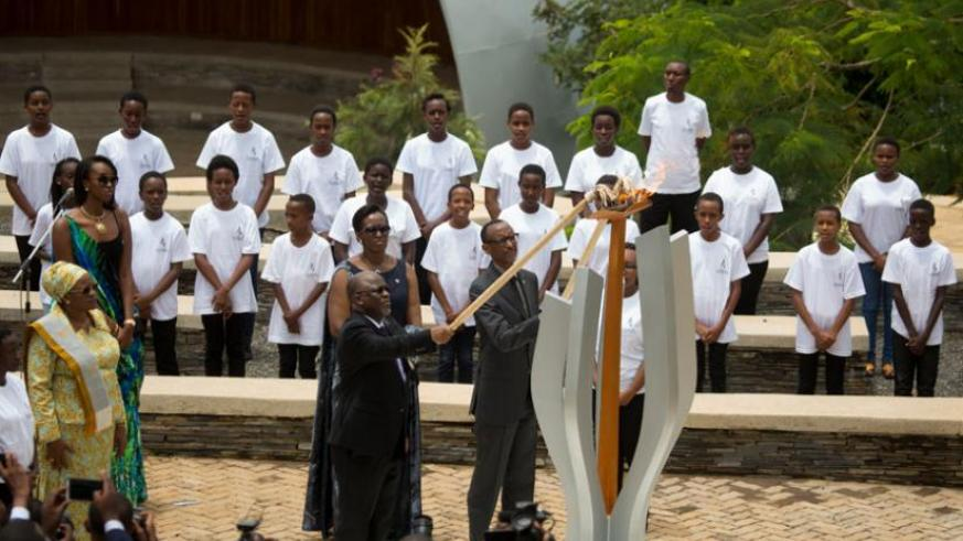 President Kagame and President Magufuli of Tanzania light the flame of Remembrance at the Kigali Genocide Memorial. Looking on are First Lady Jeannette Kagame, Tanzania's First Lad....