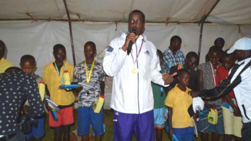 Serge Gasore after awarding the best upcoming stars in athletics in Ntarama Sector, Bugesera District. (Courtesy)