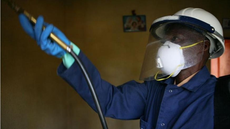 A man carries out indoor residual spraying in Bugeseera District recently. (Francis Byaruhanga)