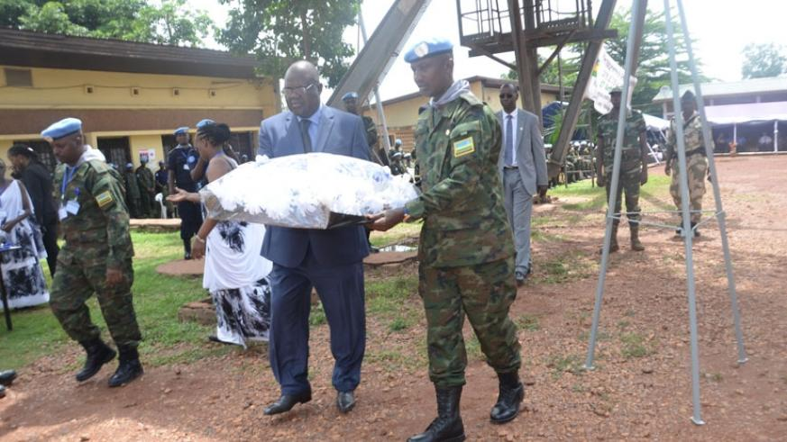 CAR defence minister Joseph Bindoume and RDF contingent commander Lt. Col. Claver Kirenga lay a wreath in honour of the Genocide victims. (Courtesy)