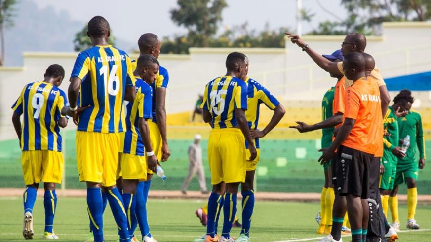 AS Kigali coach Nshimiyimana (R) stresses a point to his players during the match against Marines on Feb. 15, 2016. (Timothy Kisambira)