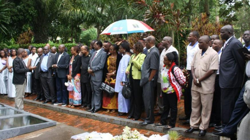 EALA MPs listen as they are briefed about the Kigali Genocide Memorial Centre. EALA will conduct a study on genocide ideology in the region next financial year. (Courtesy)