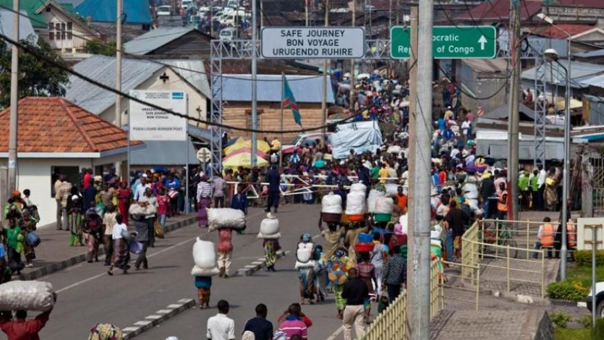 Women and other traders crossing on the Rwanda-DR Congo at Goma border post during a market day. Women still face many barriers while trading between countries. (File)