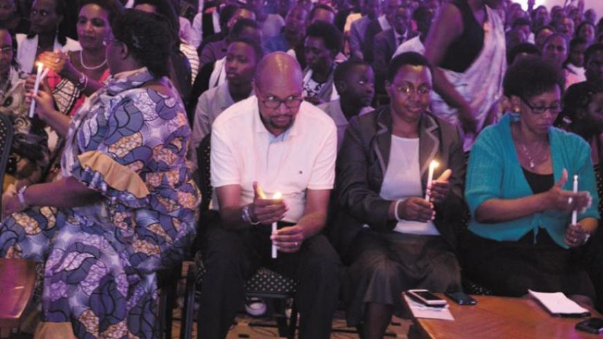 Mourners gather for a candlelighting evening in memory of Genocide victims at Kigali Serena Hotel.