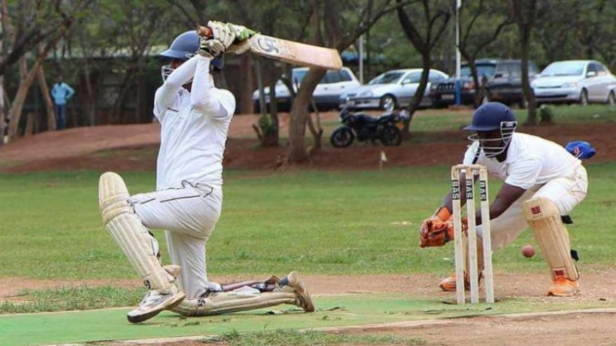 Eric Dusingizimana (L) in action against Indorwa in 50-vers premier league at Kicukiro cricket ground recently. (Courtesy)