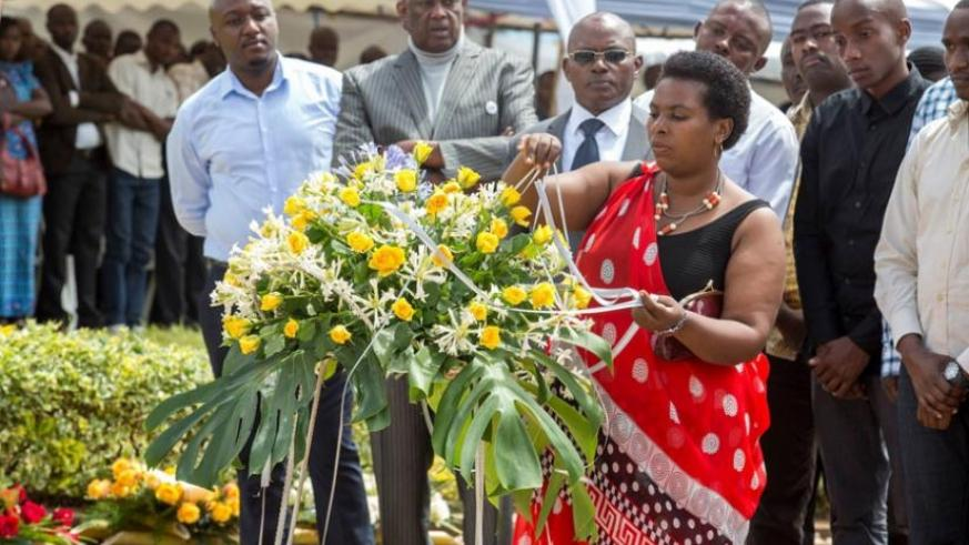 Christine Mukabunane, the spokesperson of the National Forum for Political Organisations, lays a wreath at Rebero Memorial site in Kicukiro District yesterday to pay tribute to pol....