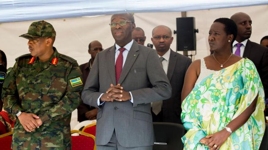 L-R; Chief of Defence Staff Gen Patrick Nyamvumba, Prime Minister Anastase Murekezi and Julienne Uwacu, the minister for sports and culture, at Rebero Memorial site while marking t....