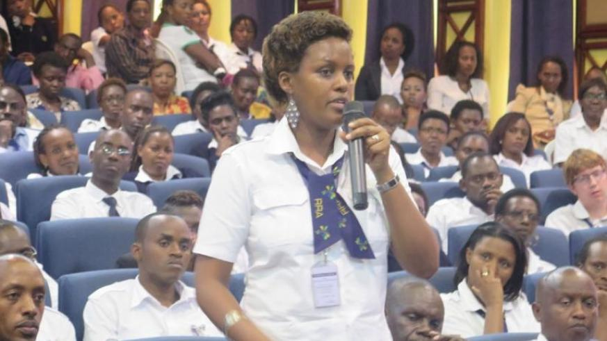 A Rwanda Revenue Authority staffer poses a question during the commemoration event at Kimihurura. (S. Muvunyi)
