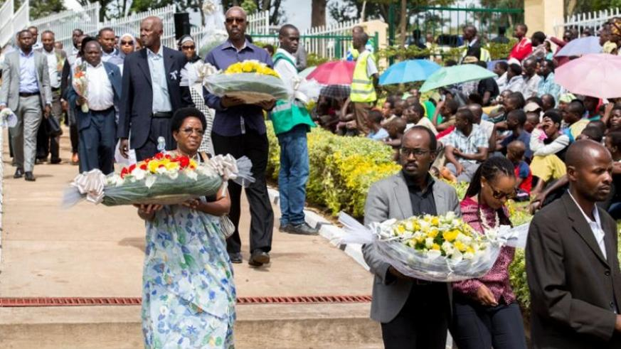 Relatives take wreath to Rebero Memorial site to pay tribute to their loved ones. (Courtesy)