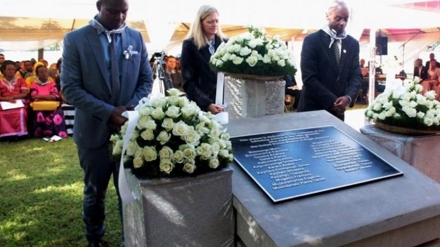 Amb. Erica Barks-Ruggles (C), Freddy Mutanguha, the regional director of Aegis Trust (L), and Dr Jean Damascene Gasanabo, of CNLG (R), pay their respects to US Embassy staff victim....