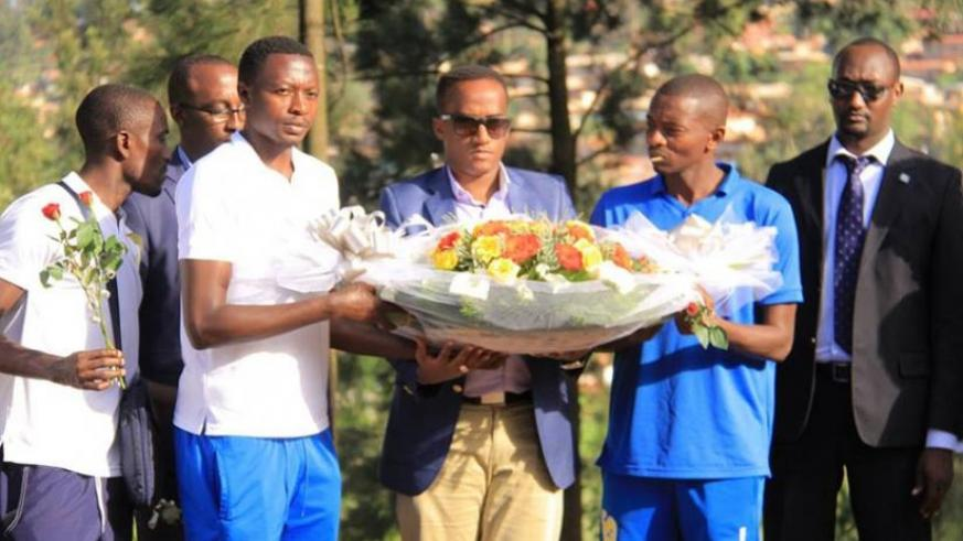 Rayon Sports FC officials and players  laying the wreath at the Kigali Genocide Memorial Center at Gisozi on Wednesday. (Jejje Muhinde)