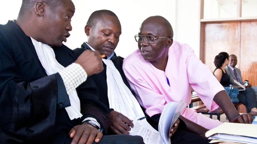 Mugesera (R) consults with his lawyers Gershom Otachi (L) and Felix Rudakemwa during his trial. (File)