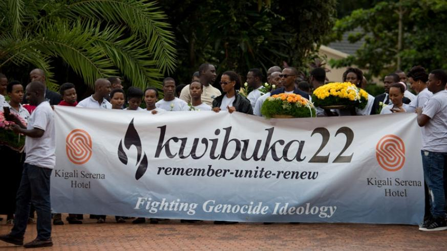 Kigali Serena Hotel employees at the Kigali Genocide Memorial Centre. Rwandan legislators are calling on other countries to enact laws against genocide ideology. (Timothy Kisambira)