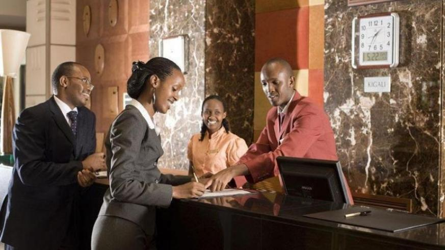 Guests being served at a front desk at a Kigali hotel. (Net photo)