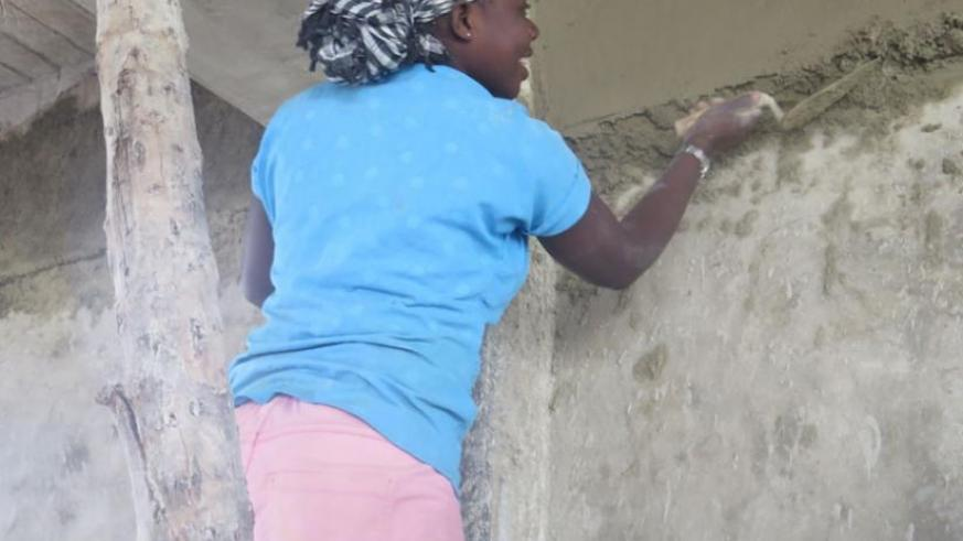 A woman builder at a construction site in Kimihurura. Women are still underpaid by site owners. (Lydia Atieno)
