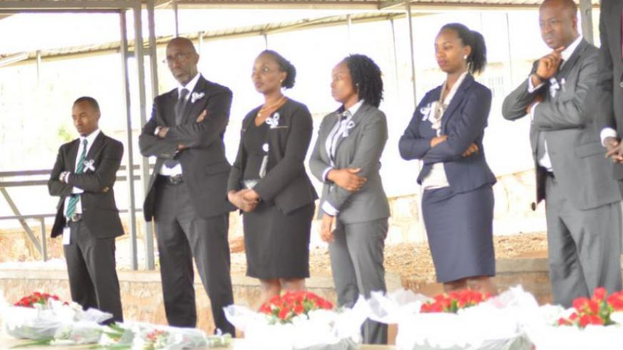 Access Bank management lay wreaths at the graves to honor victims. (Courtesy)