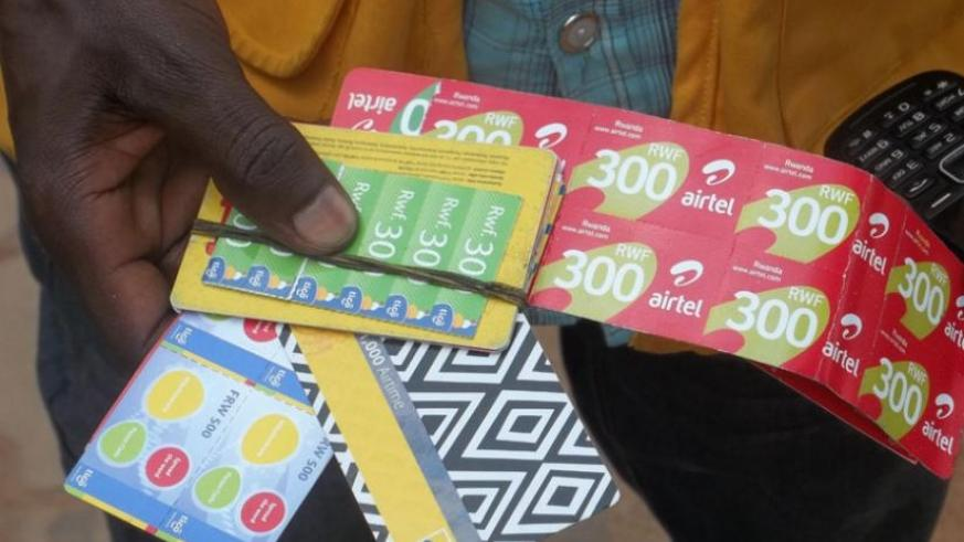 A vendor sells airtime cards of all the three telecom firms operating in Rwanda. There are over 8.8 million Rwandans with mobile phone presently. (File)