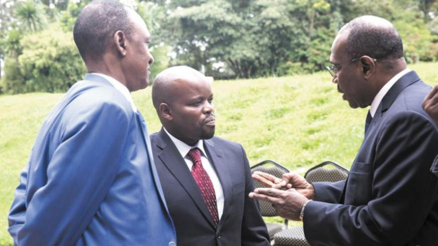 Toure (R) chats with Nsengimana (C) and Mali's ICT minister on Monday. (File)