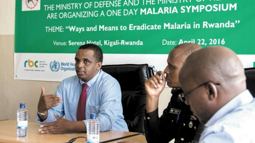 Dr Ntaganda (L) addresses the media on preparations for the malaria symposium as other officials look on. (Doreen Umutesi)