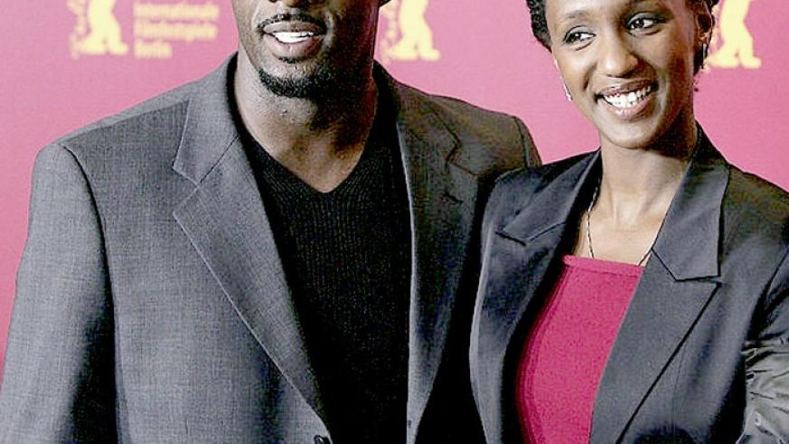 British actor Idris Elba (L) with Rwandan actress Carole Karemera during a presentation of the film 'Sometimes in April' at a press conference at the Berlinale Filmfestival in Berl....