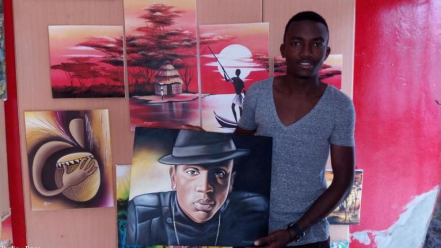Girihirwe poses with his finished piece of R&B singer Christopher Muneza.