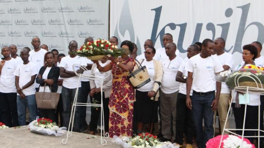 Staff of I&M Bank lay a wreath on the grave at Gisozi Genocide memorial centre. (Francis Byaruhanga)