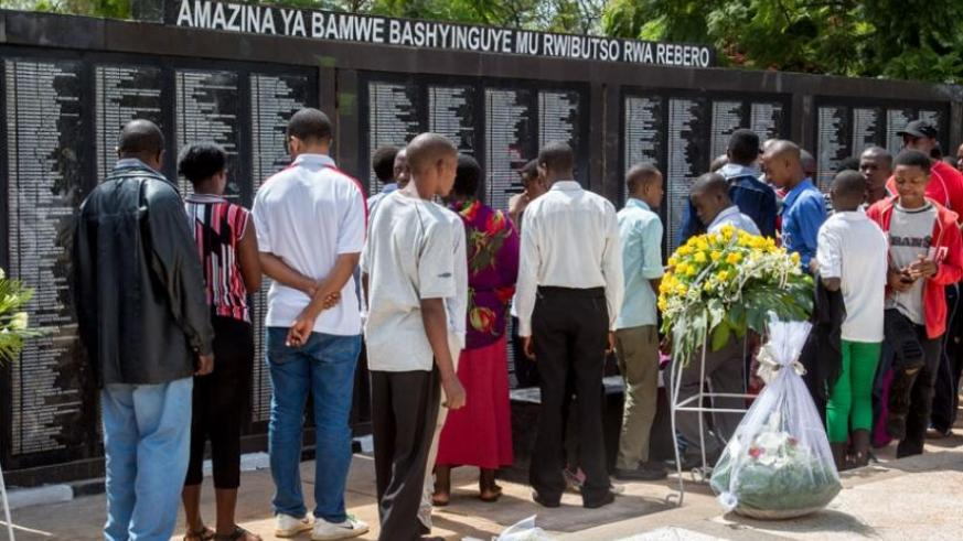 Mourners view names of people who were killed during the 1994 Genocide against the Tutsi that are laid at Rebero Memorial site while marking the end of the commemoration week yeste....
