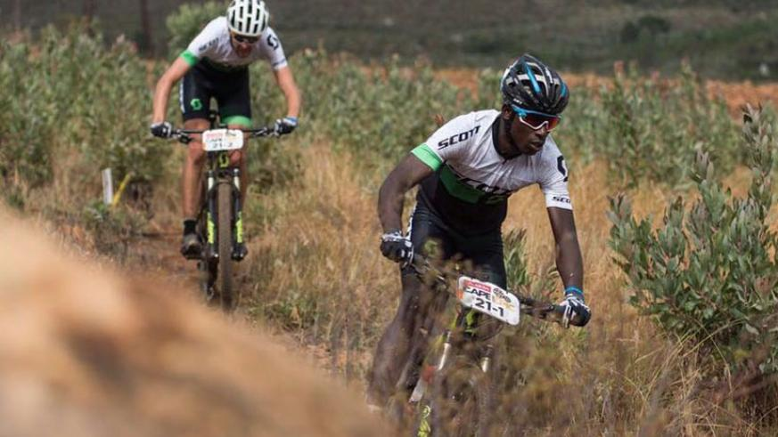Nathan Byukusenge (front) in action during this year's Absa Cape Epic in South Africa. The Rwandan cyclists has qualified for the Rio Olympics Mt. Bike. (Courtsey)