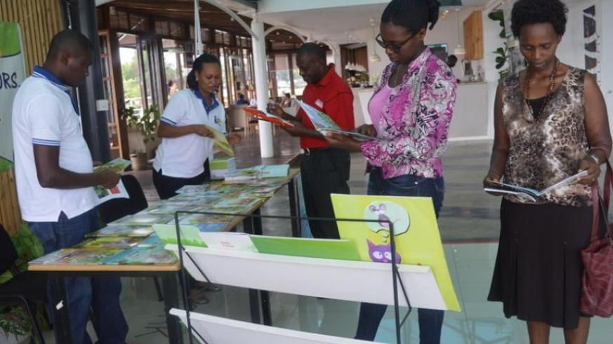 Publishers and buyers interact at the Kinyarwanda children's books exhibition on Friday. (Samantha Teta)