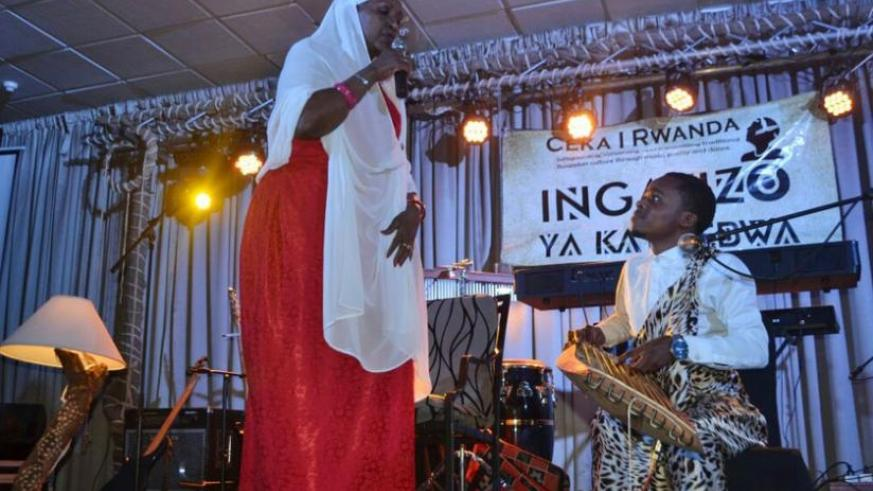 Munyakazi performs with Cecile Kayirebwa, one of the country's most successful traditional musicians and KORA Award Best Traditional Artist Female 2016 nominee, during the 'Inganzo....